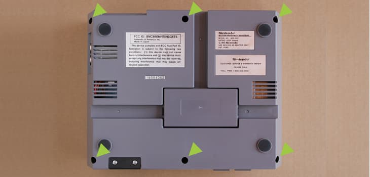 Remove the six screws to open the NES housing