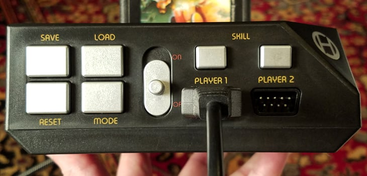 Control buttons on the front of the RetroN 77 - including Save and Load