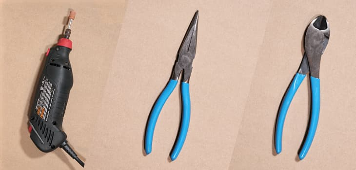 A dremel tool, pliers, and flush cutters