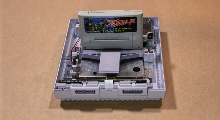 A Super NES with the top removed