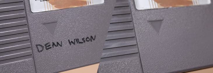 NES game cartridge before and after removal of permanent marker writing