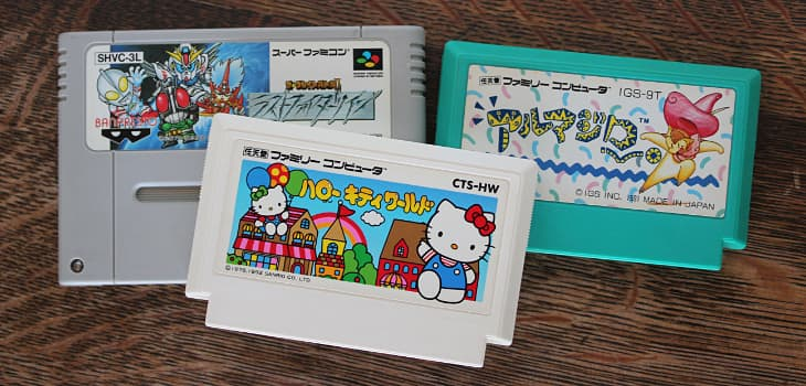 Three game cartridges - one Super Famicom, two Famicom games
