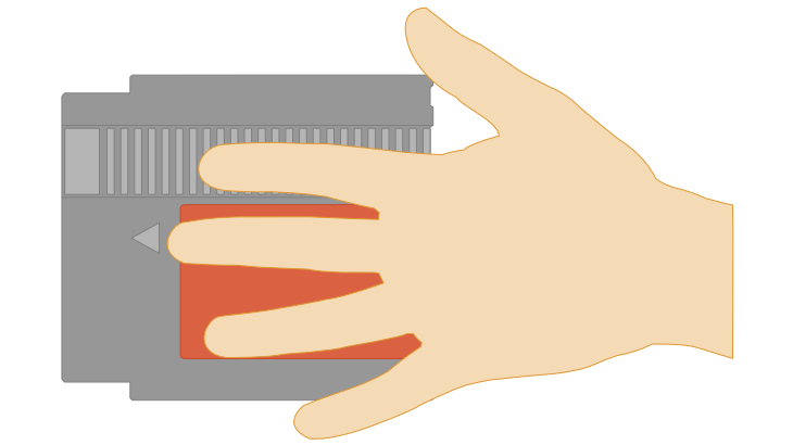 Illustration of NES cartridge size compared to a hand