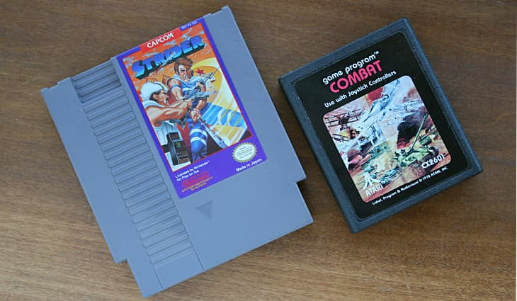 NES Cartridge - Strider next to Atari Cartridge - Combat