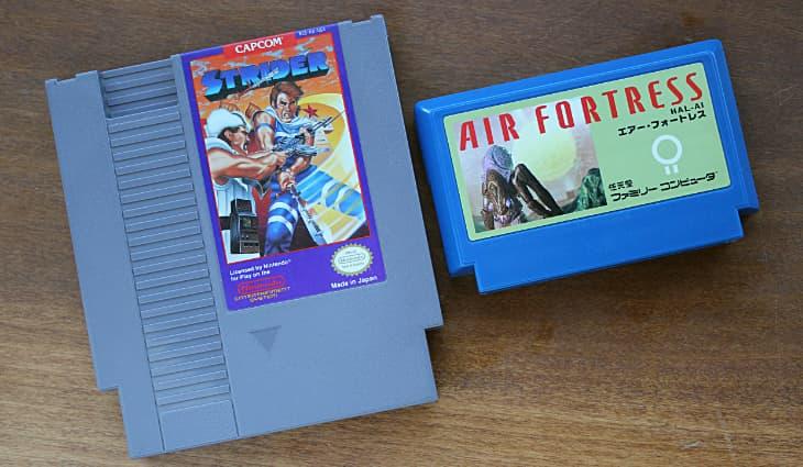 NES Cartridge - Strider next to Famicom Cartridge - Air Fortress