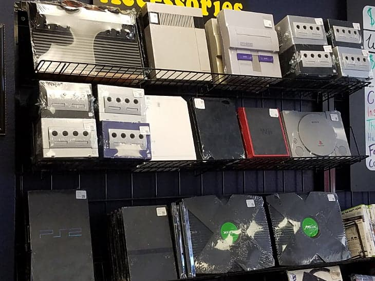 Photo of consoles for sale in retro game store