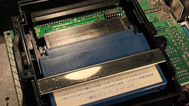 Famicom cartridge in Gyromite adapter in NES