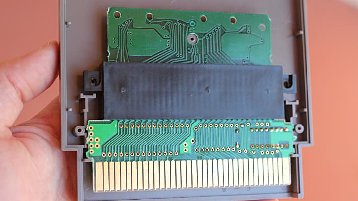 Opened NES Game Cartridge (Gyromite) showing adapter (black, in center)